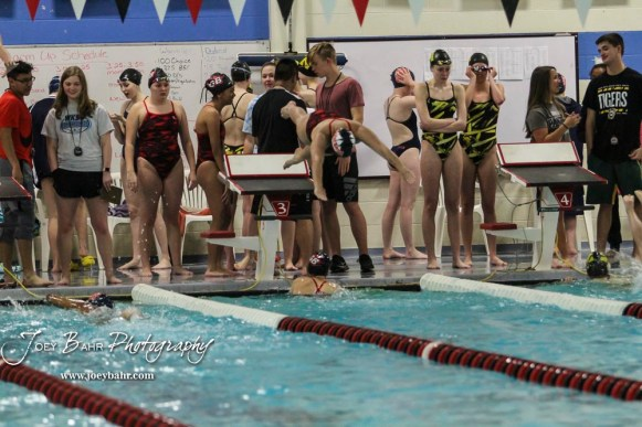 Great Bend's Amy To dives into the pool as Emma Mayhill touches the wall. The Great Bend Girls Swimming Invitational was held at the Kirkman Activity Center on the campus of Barton Community College in Great Bend on 4 20190426, 2019. (Photo: Joey Bahr, www.joeybahr.com)