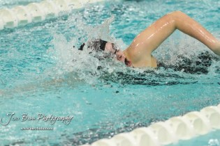 Katherine Snapp takes a breath as she swims in the 400 yard Freestyle Relay. The Great Bend Girls Swimming Invitational was held at the Kirkman Activity Center on the campus of Barton Community College in Great Bend on 4 20190426, 2019. (Photo: Joey Bahr, www.joeybahr.com)