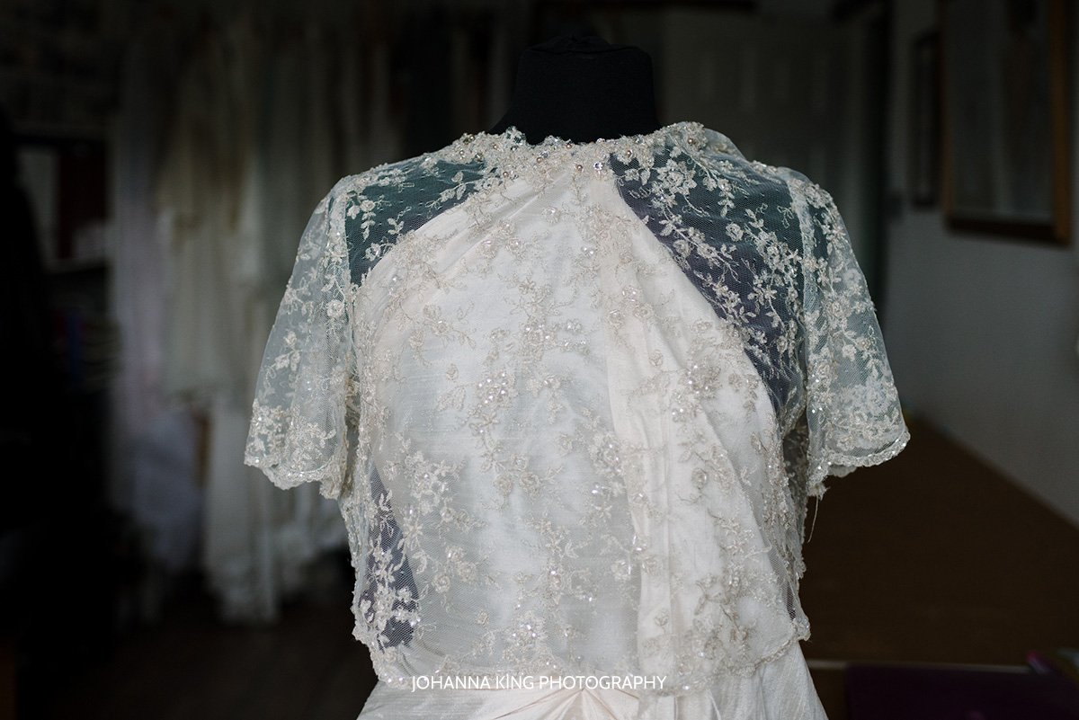 Sarah showing one of a lace bridal bolero from her new accessory line