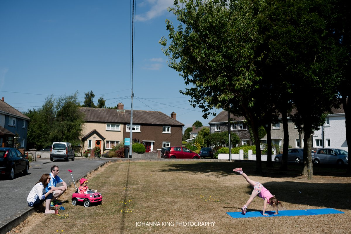 The family enjoying the sun in the green Dearbhla doing a cartwheel