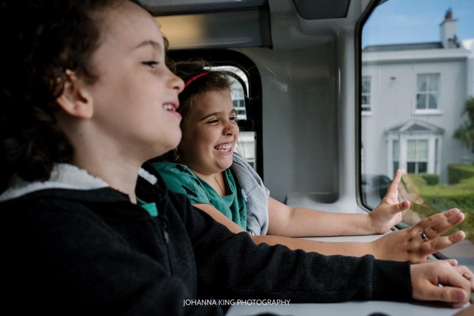 Children having fun in Dublin bus on their way into town