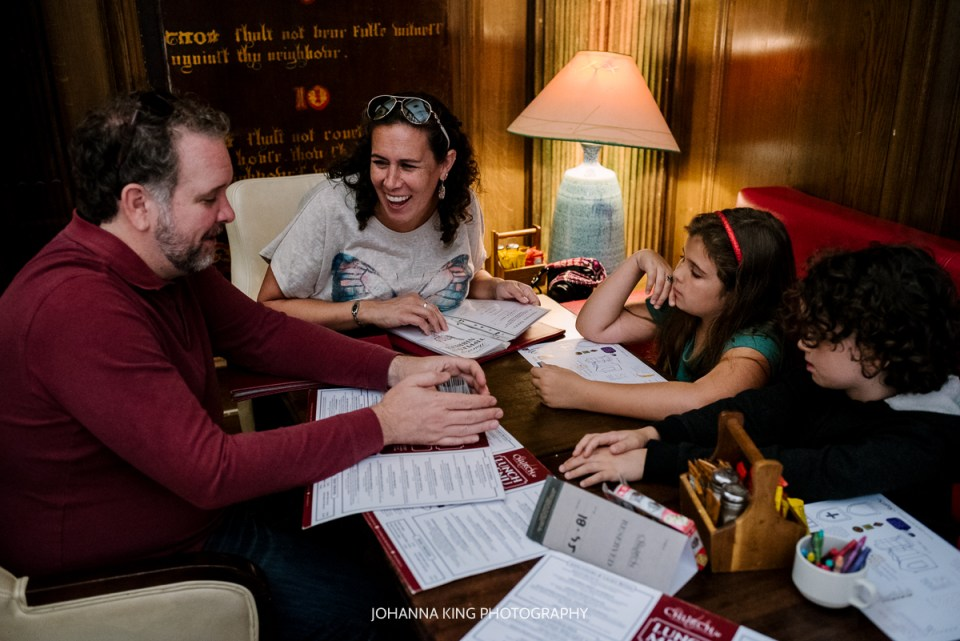A family playing board game in a pub restaurant in Dublin