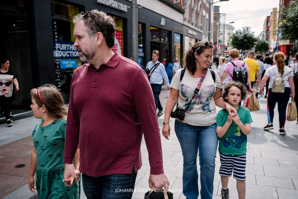 A last family portrait while walking in the busy Henry Street in Dublin