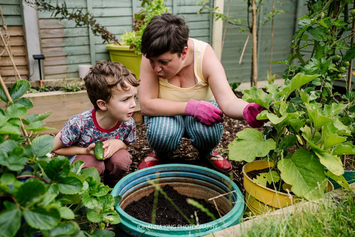 A mother and her son looking at their growing vegetables in their Dublin city garden