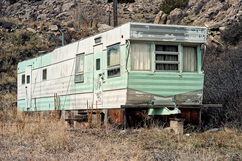 Streamliner Mobile Home along Colorado Highway 14's Poudre Canyon. Larimer County, Colorado (2015)