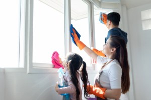 Kids cleaning a home window