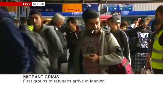 muslim-migrant-refugee-cigarette-iphone