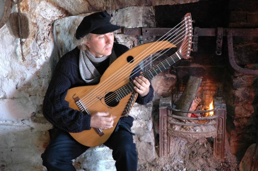 John Doan performs harp guitar in ancient celtic cottage in Aran Islands.