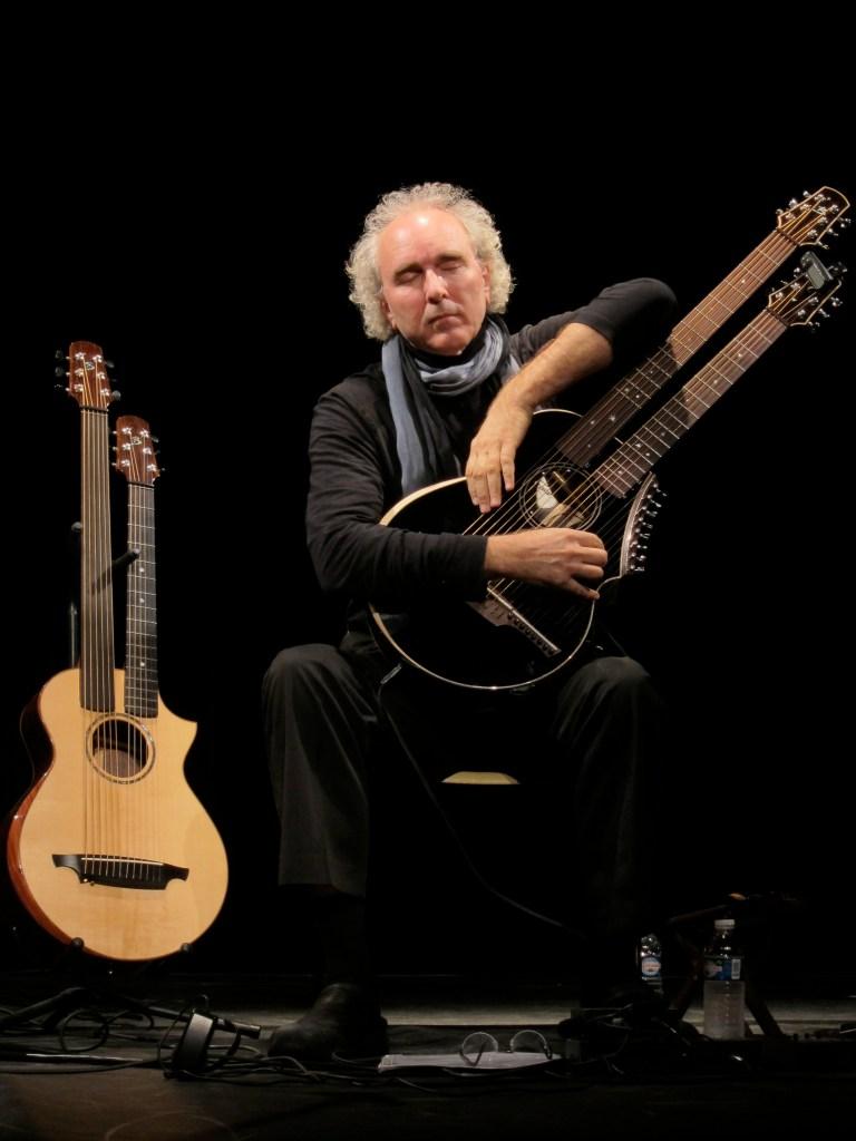John Doan playing Brunner Harp Guitar on stage in concert
