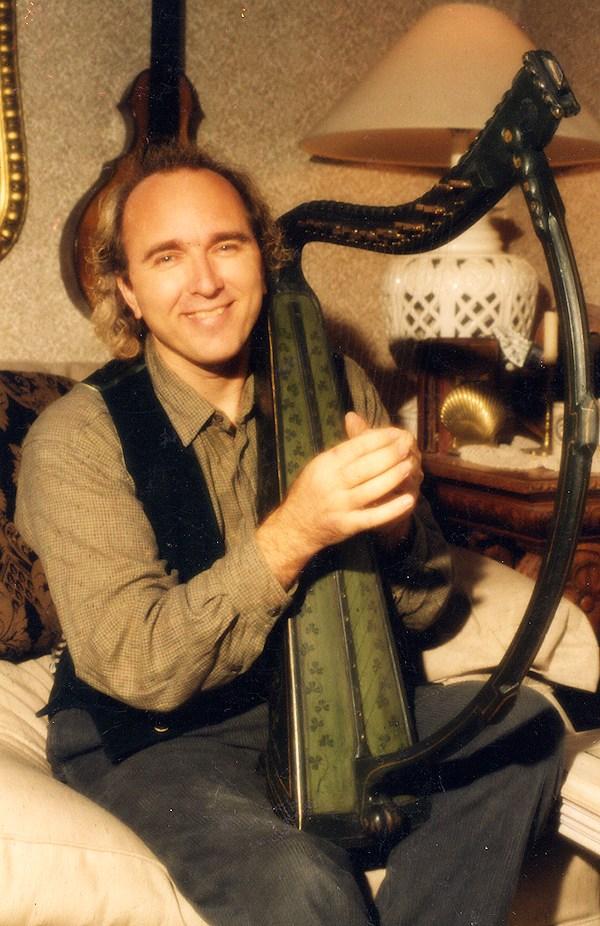 John Doan with a celtic harp