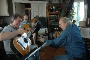john doan harp guitar retreat john holds guitar over head of student threateningly