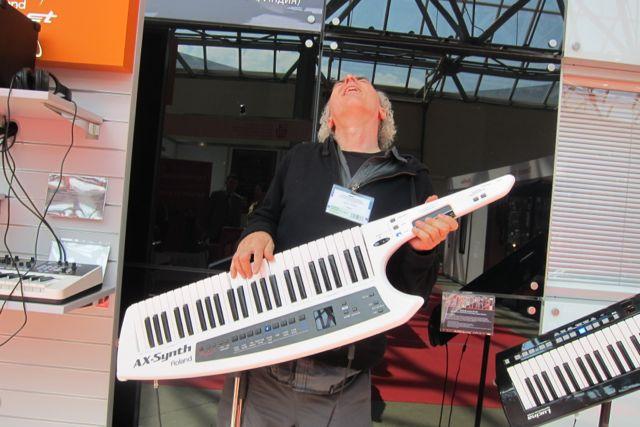 John Doan jamming on an electric piano guitar in Moscow.