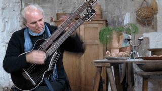 john doan playing harp guitar in England.