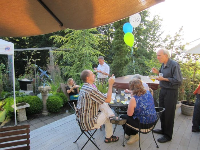 Potluck outdoors at John Doan home summer concert.