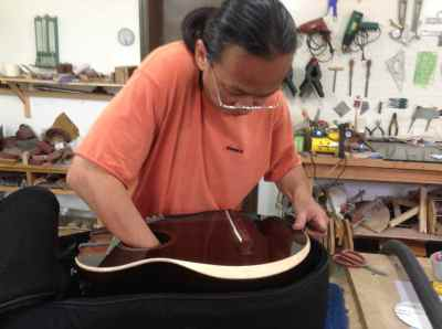 33. Mr. Xi fixes Harp Guitar