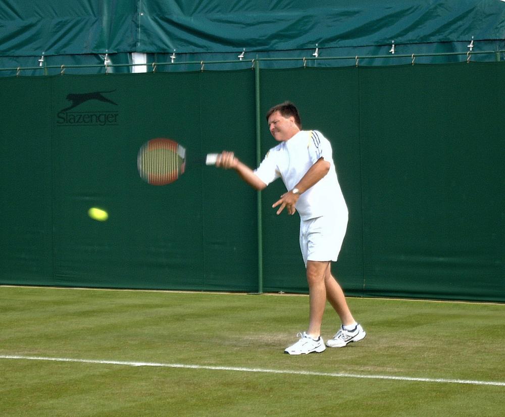 Dr. John F Murray coaching tennis at Wimbledon