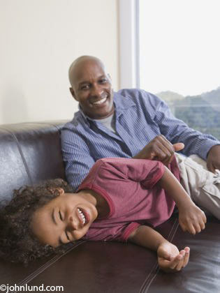 Black African American Father Playing With Son