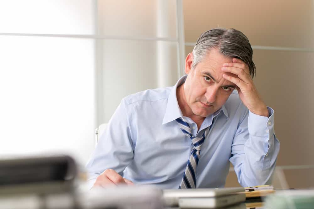 Image of a frustrated CEO because his Adspend is bringing in a return on investment like his addiction recovery SEO blog marketing