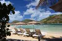 Row of beach chairs on Pinel Island