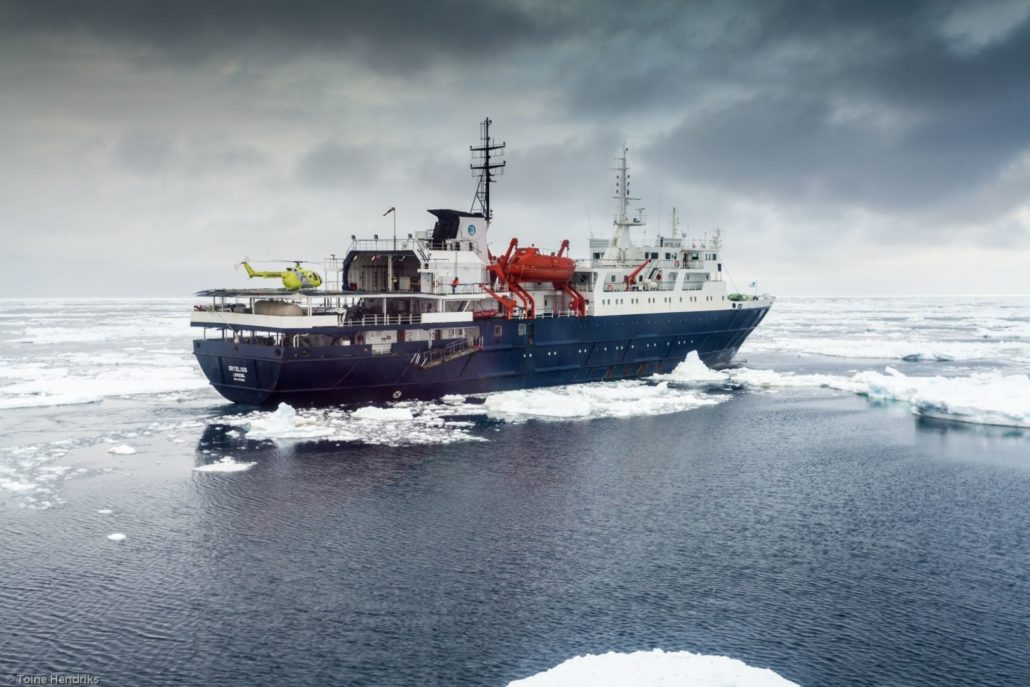 Ortelius in the Ross Sea with helicopter (Credit: Toine Hendriks and Oceanwide Expeditions)