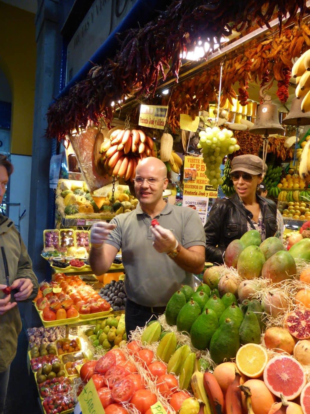 Vendors at the Mercado de Vegueta encourage shoppers to sample the merchandise