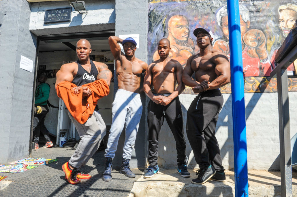 Tumi, left, is an artist who also runs a popular body building gym next to his grandmother's home