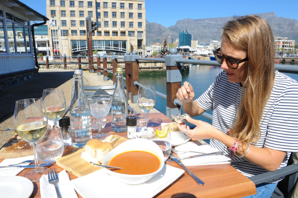 Enjoying oysters, lobster bisque and the view at Den Anker, a Belgian restaurant that overlooks the harbor in Cape Town