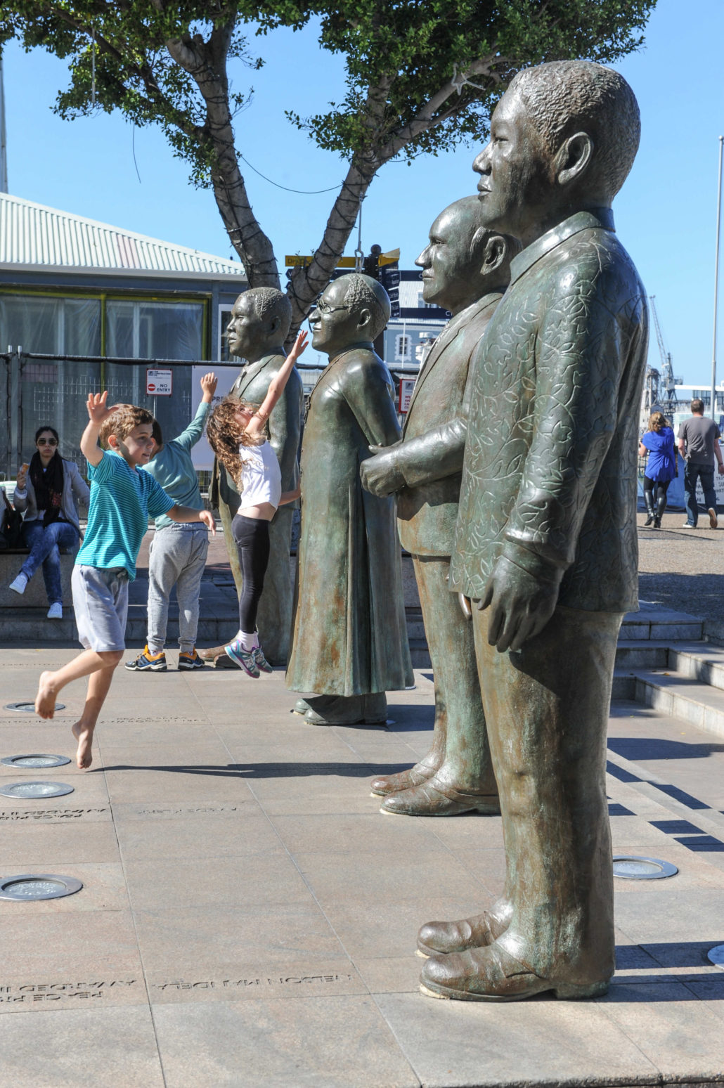 Bronze statues of four men who collectively brought down apartheid peacefully stand in the Waterfront