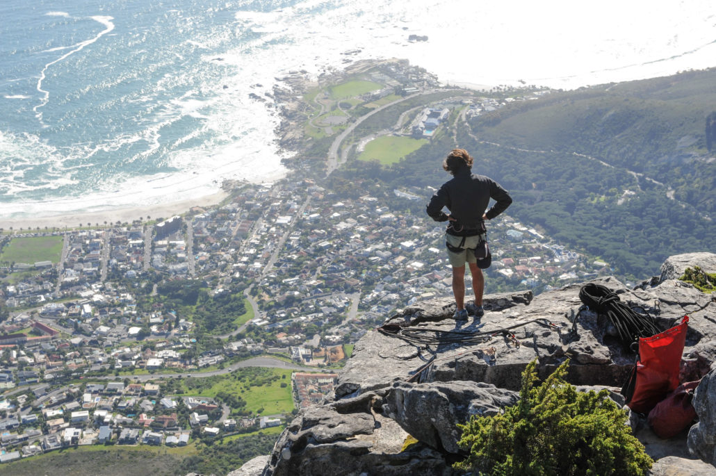 Climbers reach the top of Table Mountain and enjoy the view of the Atlantic below