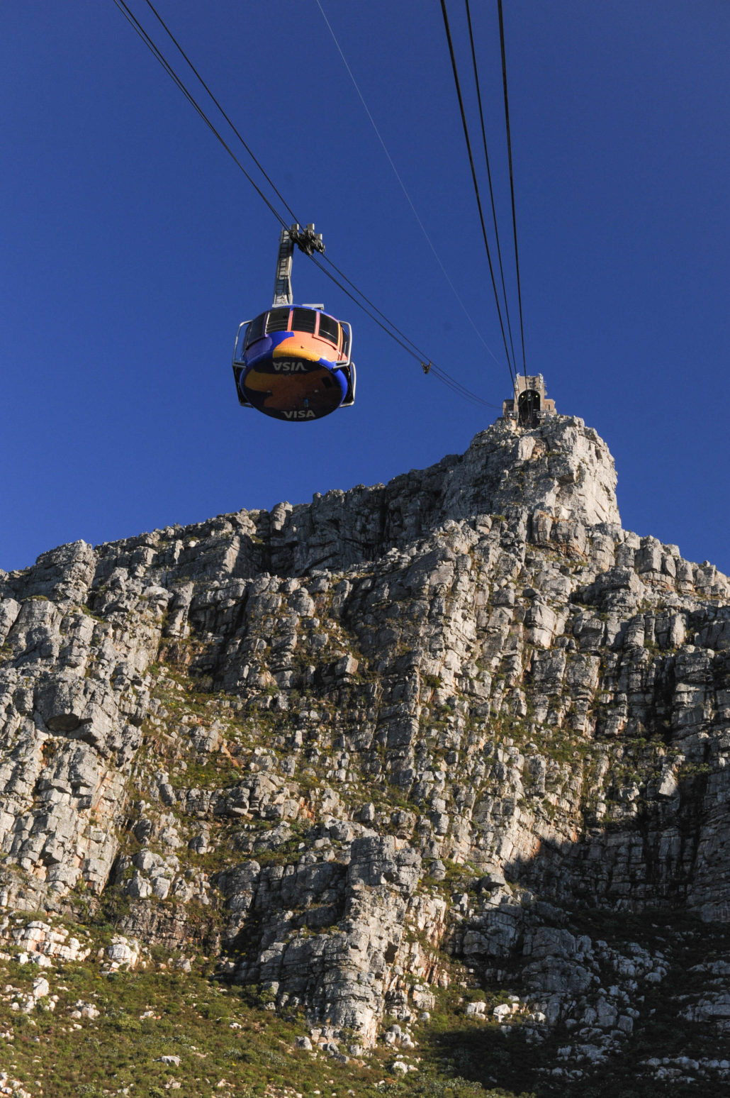 One can reach the top of Table Mountain at 3,500 feet in less than five minutes in the new rotating cable cars
