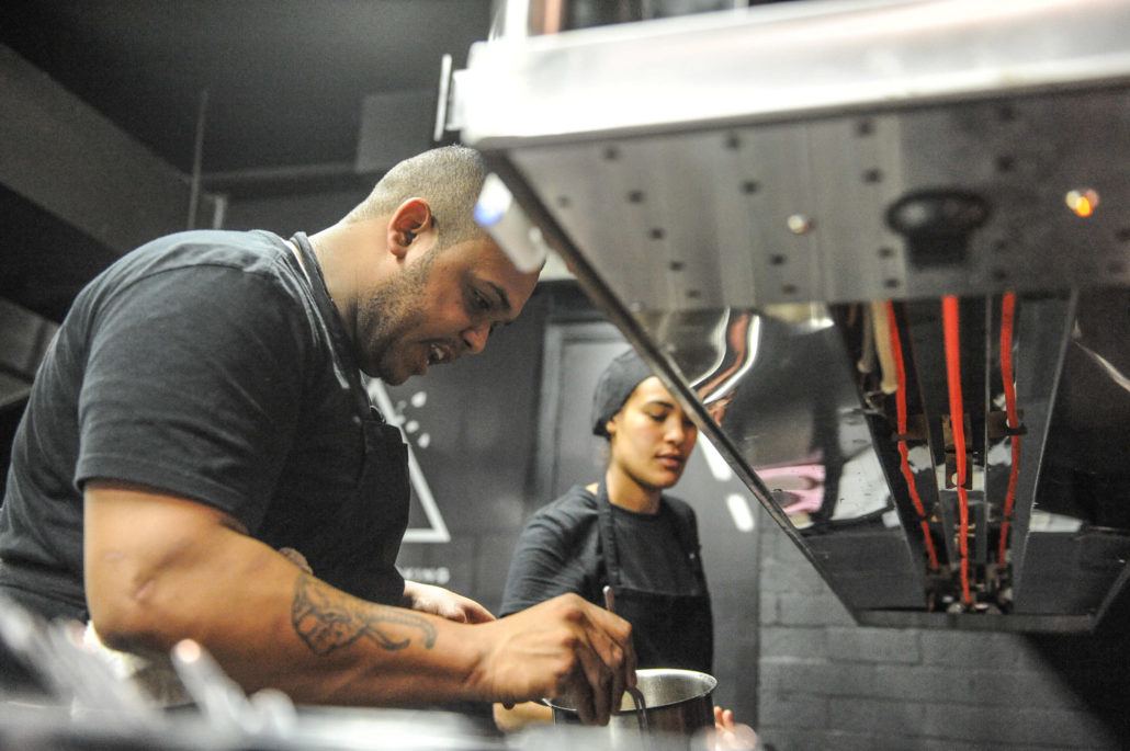 Chef working in the open kitchen at Ash, a trendy new restaurant in Cape Town