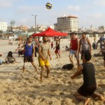 Palestinians enjoy a day at the beach in Gaza City