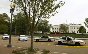 Police cars are parked in front of the White House as Pennsylvania Avenue remains closed to pedestrian traffic in Washington