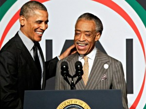 President Barack Obama shakes hands with Rev. Al Sharpton as he arrives to speak at Sharpton's National Action Network conference, Friday, April 11, 2014, in New York. (AP Photo/Frank Franklin II)