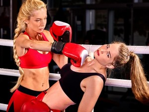Two women boxer wearing red gloves to box in ring.