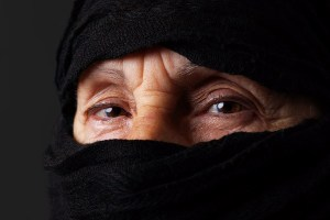 Eyes of senior muslim woman with niqab, looking at camera