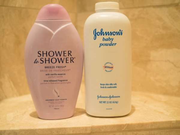 Bottle of Shower to Shower and Johnson's Baby Powder