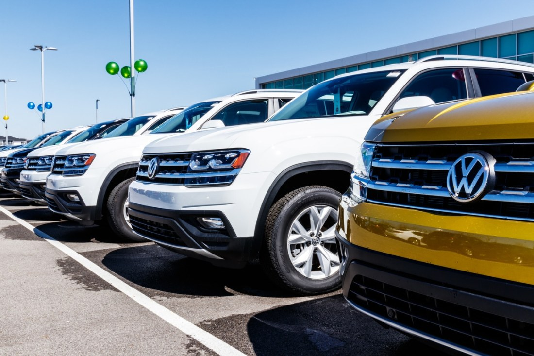 Front end of Volkswagen vehicles lined up at a dealership