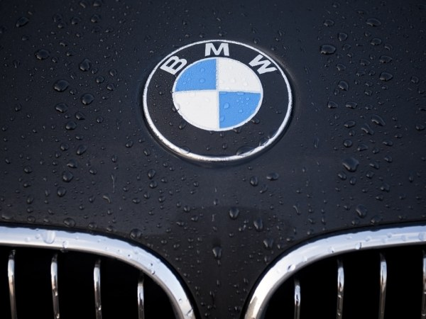 image of BMW logo on the hood of a car