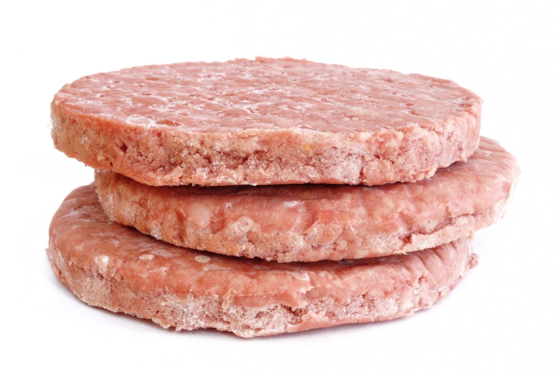 image of three frozen burger patties stacked on top of each other