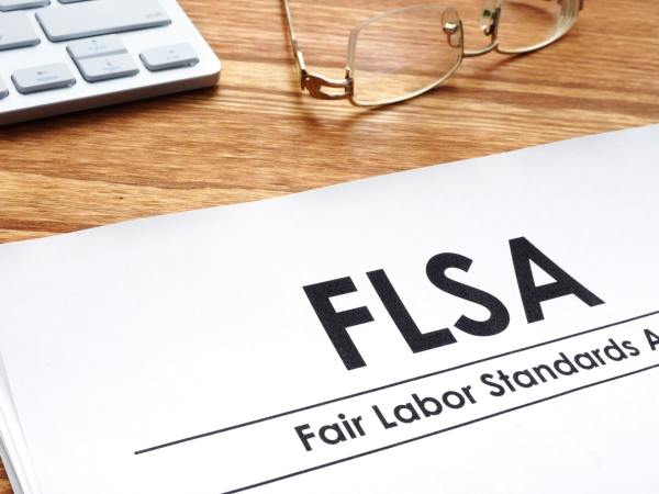 Fair labor standards act FLSA on a desk.