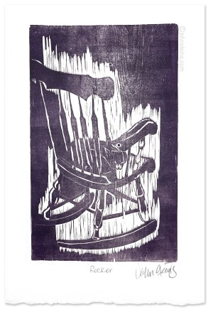 Hand printed woodcut print of a cat curled up in a rocking chair