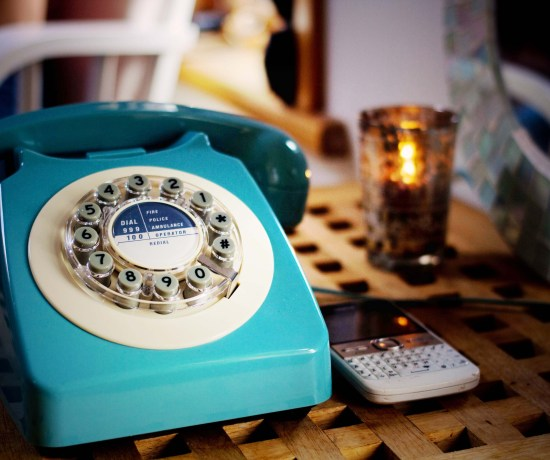 Blue vintage style telephone with dial