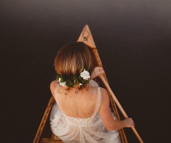 Bride in rowing boat taken from above Jennifer Moher