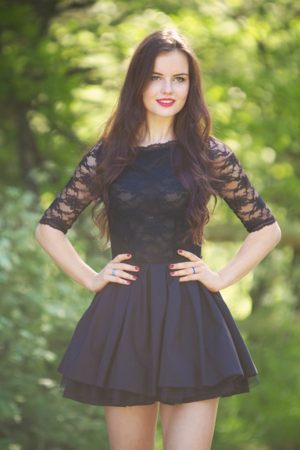teen-wearing-black-lace-skater-dress