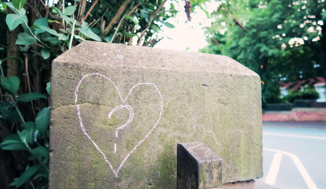 Heart drawn in chalk on gatepost