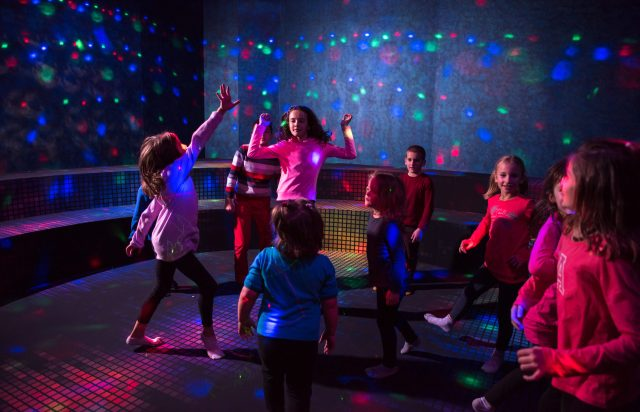 A group of joyful children happily spending time at Kids neon disco party