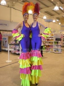 Stilt walkers at a store opening