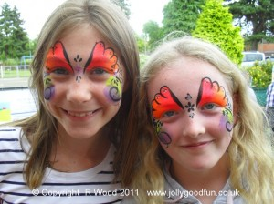 Two happy girls with their faces painted
