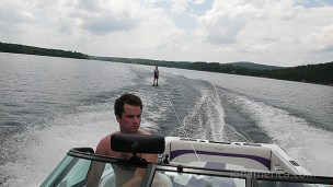 Jared's driving the boat, unimpressed with Tom's antics